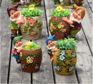 China Resin garden gnome elf figurine flower pot garden decoration on sale