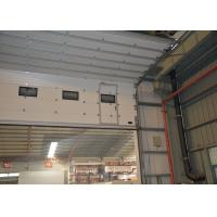 Buy cheap Half enclosed track design PU panel sectional overhead doors with air tight performance product