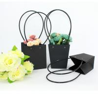 Quality Waterproof Flower Packaging Carry Kraft Paper Bag With Plastic Handle for sale