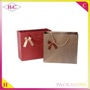 Buy cheap La fabricación y la venta manejan el bolso de compras más barato exclusivo de papel del regalo del vino con bowknot product
