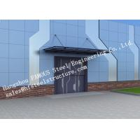 China Automatic Glass Sectional Industrial Garage Doors Steel Buildings Kits Superior Weather Resistance on sale