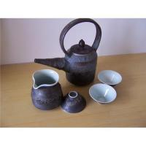 Vitrificação fina do efeito do metal de potenciômetro do chá da porcelana
