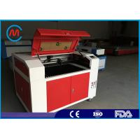 China Mini Rotary Laser Wood Carving Machine Auto Focus Motorized Up And Down Table on sale